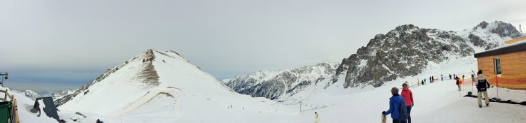 View from Shymbulak at 3,200m. Almaty is under the toxic orange cloud at the bottom left.